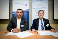 (from left to right): Siraaj Adams (Metropolitan Health) and Alonzo Wind (USAID Deputy Mission Director) signing the Memorandum of Understanding.